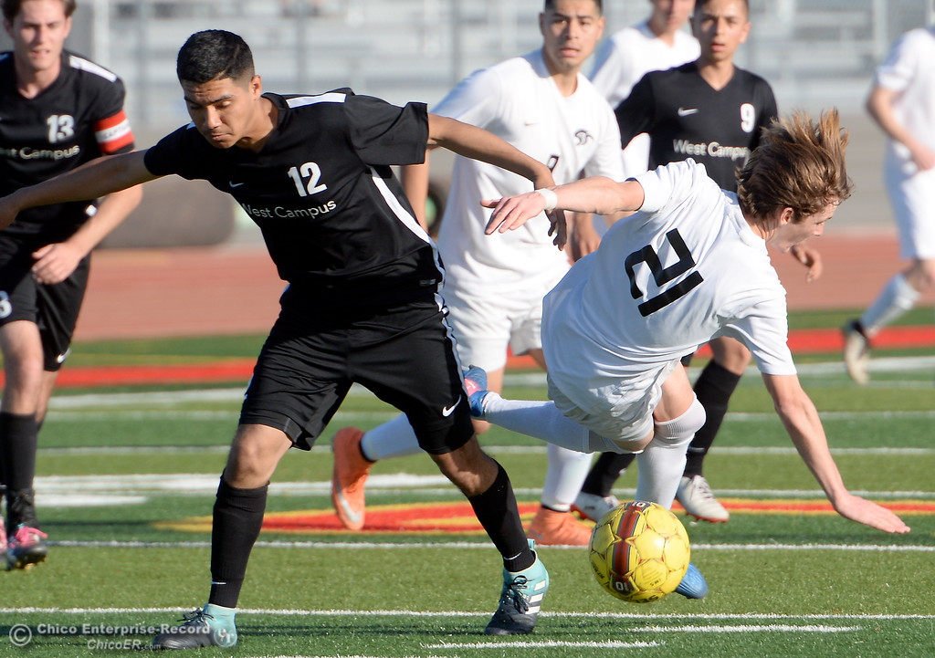 . West Campus #12 Rodolfo Lozano collides with Chico #21 Rory Monninger during a hard fought first round of the NorCal state playoffs Chico High vs West Campus boys soccer at Chico, Tues. March 6, 2018. (Bill Husa -- Enterprise-Record)