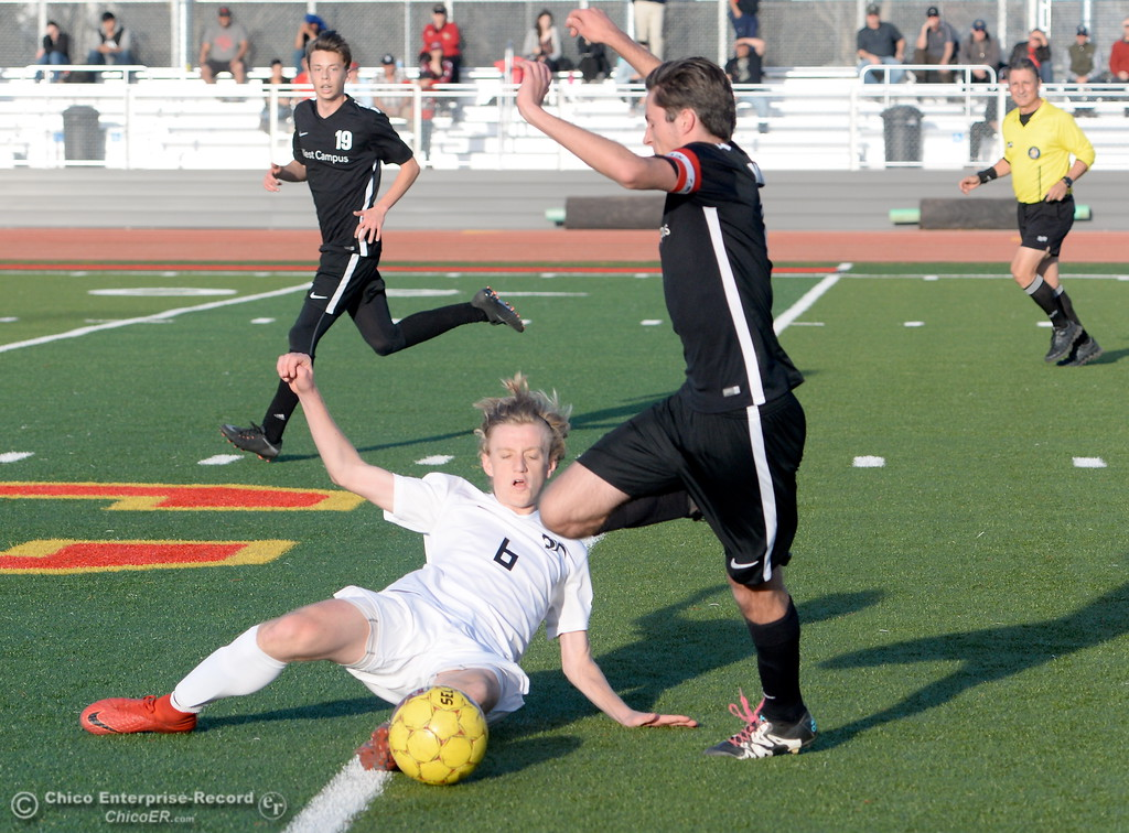 . Chico #6 succeeds with this slide tackle during the first round of the NorCal state playoffs Chico High vs West Campus boys soccer at Chico, Tues. March 6, 2018. (Bill Husa -- Enterprise-Record)