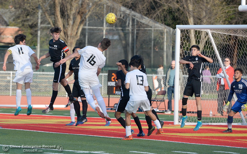 . Chico players Alvaro Ortiz-Hernandez, Kobe Hood and Christian Valles battle in front of the West Campus net during the first round of the NorCal state playoffs Chico High vs West Campus boys soccer at Chico, Tues. March 6, 2018. (Bill Husa -- Enterprise-Record)