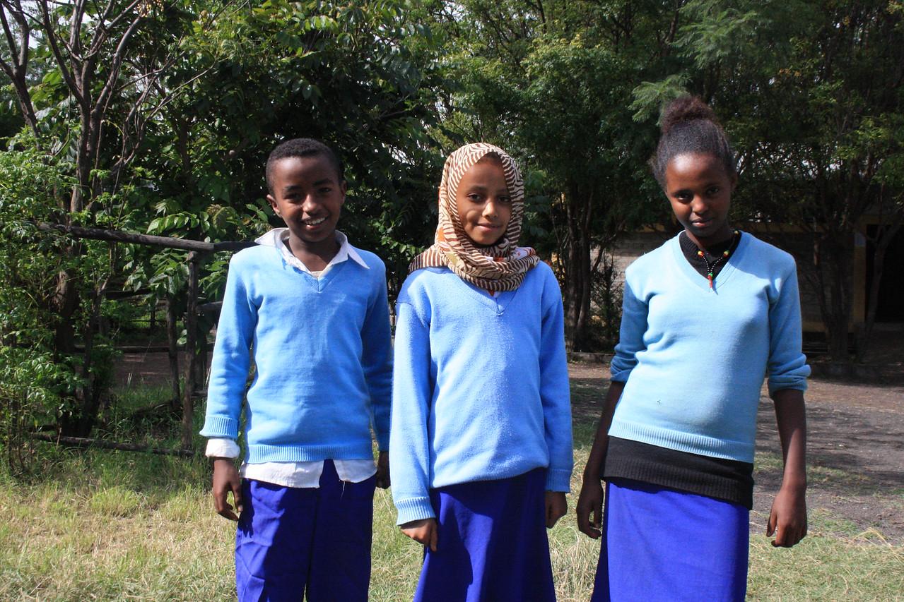 From  Left to right - Henok Yikunoamlak (boy), Halima Indris (middle girl) Haymanot Kebede-Lemlem Tesfa Students