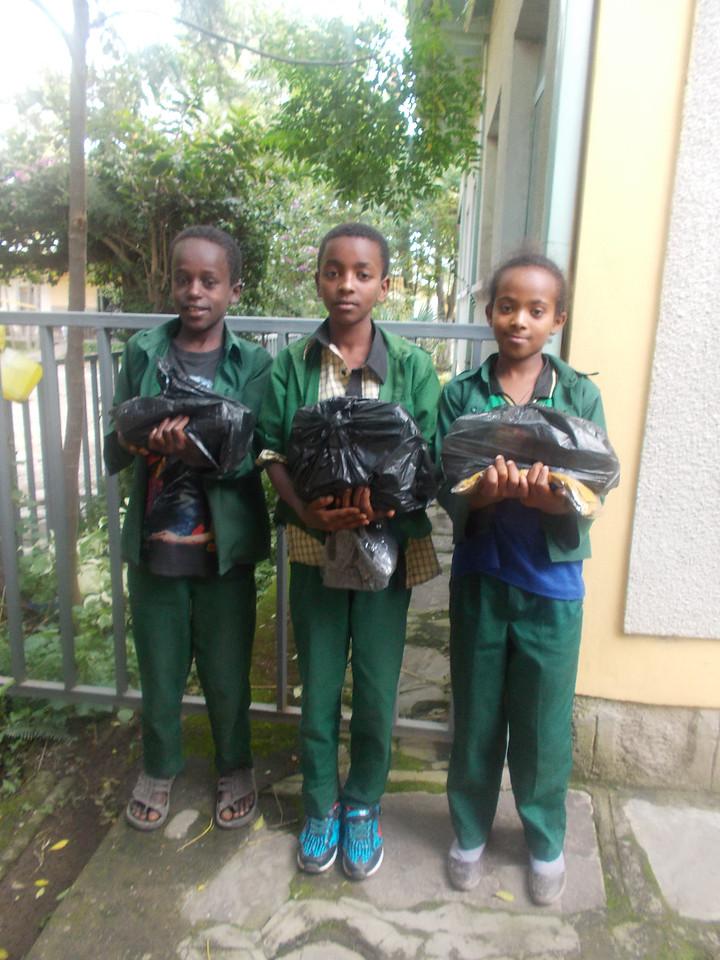 A boy with little bit dark color is Meka Amde, Yonas Abebe (boy in the middle), and Sintayehu Abebe(girl)-Kerehora