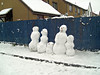 Some snowmen awaiting their fate (they were knocked over the next morning)