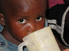 Drinking porridge,K-MET Clinic, Nymasaria, Kisumu, Kenya, June - Sept 2009