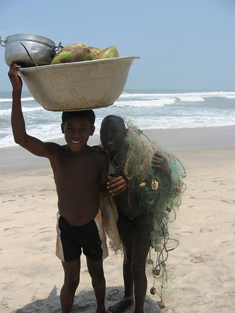 "These boys were returning to their fishing village near Anamabu Beach, close to the town of Cape Coast.  They had been sent to gather coconuts, and bring back a mended fishing net. This photo was taken on a weekday and these boys were not in school, either because they were ""working"", or did not attend school because of insufficient funds for uniforms, books, etc."