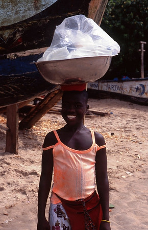 Girl selling water, Ghana