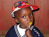 Little Boy and Yellow Lollipop