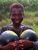Girl selling watermelons, Ghana