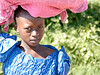 Girl in Blue Dress Carrying Pink Cover on Head