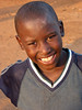 Kamwokya Boy in Blue and Gray Shirt