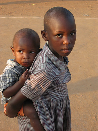 Young Girl Taking Care of Her Younger Brother, Kampala, Uganda