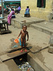 Bathing on the street in Elmina