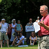 """Community members in Lunenburg held a """"Children Belong Together"""" at the gazebo in town on Saturday. Rev. Ernie Farrar the pastor from the United Parish of Lunenburg addresses the crown at the event. SENTINEL & ENTERPRISE/JOHN LOVE"""