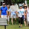 "Community members in Lunenburg held a ""Children Belong Together"" at the gazebo in town on Saturday. SENTINEL & ENTERPRISE/JOHN LOVE"
