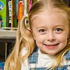 photo of girl in front of bookshelf