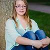 photo of girl sitting on tree