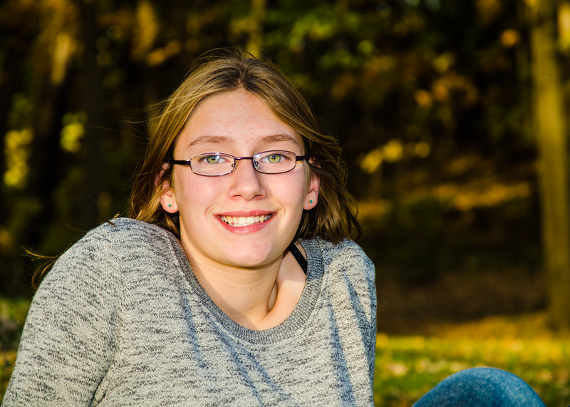 photo of girl with glasses sitting