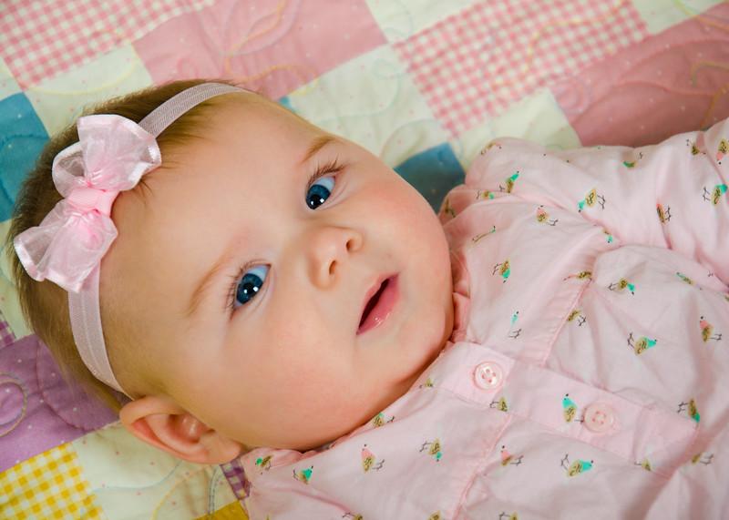 blue eyed baby on blanket photo