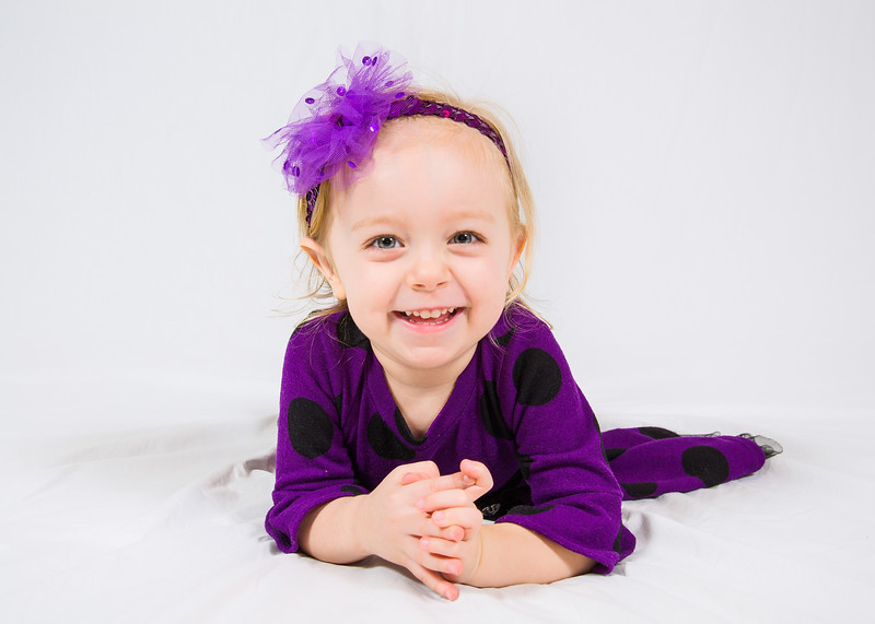 Photo of child in purple shirt