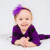 Photo of child in purple shirt
