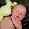 Photo of newborn with toy bunny