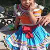 A Darling Little Nahua In Her Colorful Dress In Chilapa, Guerrero