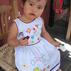 A Tiny Huichol Girl Saving A Little Chocolate For Later