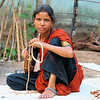 "taken at Kallaporum  gypsy camp. Indian Gypsy mother making beads. this is her only income. it takes her almost a whole day to make one 16"" necklace. She will only get £0.30 - $0.25.  many days her children go hungry.<br /> <br /> *+ALL MONEY RAISED FROM SALE OF MY ART, AND DONATIONS MADE VIA OUR CHARITY WEBSITE, GOES TO HELP THESE PRECIOUS CHILDREN. WE TAKE NOTHING OUT OF WHAT YOU GIVE TOWARDS CHARITY OVERHEADS. WE ARE NOT SALARIED AND COVER OUR OWN TRAVEL EXPENSES. SO ALL THAT YOU GIVE GOES TO THESE CHILDREN+*<br /> <br /> To make a donation, or find out more, Please visit our Charity Mission website: *""http://www.philadelphia33.org/*"" <a href=""http://www.philadelphia33.org/"">http://www.philadelphia33.org/</a>"