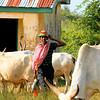 "Young herdsman. He will walk  for miles with his cattle to graze and drink. The building in the back used to be a school and Small Medical center. Funding run out. We want to purchase it and use it again. There is great demand for Both School and Pharmacy here.<br /> <br /> *+ALL MONEY RAISED FROM SALE OF MY ART, AND DONATIONS MADE VIA OUR CHARITY WEBSITE, GOES TO HELP THESE PRECIOUS CHILDREN. WE TAKE NOTHING OUT OF WHAT YOU GIVE TOWARDS CHARITY OVERHEADS. WE ARE NOT SALARIED AND COVER OUR OWN TRAVEL EXPENSES. SO ALL THAT YOU GIVE GOES TO THESE CHILDREN+*<br /> <br /> <br /> To make a donation, or find out more, Please visit our Charity Mission website: *""http://www.philadelphia33.org/*"" <a href=""http://www.philadelphia33.org/"">http://www.philadelphia33.org/</a>"