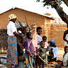 "Village hairdressers. This is where the ladies meet each evening after working in the fields. <br /> <br /> *+ALL MONEY RAISED FROM SALE OF MY ART, AND DONATIONS MADE VIA OUR CHARITY WEBSITE, GOES TO HELP THESE PRECIOUS CHILDREN. WE TAKE NOTHING OUT OF WHAT YOU GIVE TOWARDS CHARITY OVERHEADS. WE ARE NOT SALARIED AND COVER OUR OWN TRAVEL EXPENSES. SO ALL THAT YOU GIVE GOES TO THESE CHILDREN+*<br /> <br /> To make a donation, or find out more, Please visit our Charity Mission website: *""http://www.philadelphia33.org/*"" <a href=""http://www.philadelphia33.org/"">http://www.philadelphia33.org/</a>"