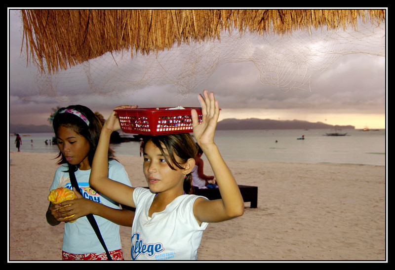 Two Pilipina girls selling fancy jewelry at White Sands Beach, Boracay Island, Aklan, Philippines.