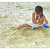 A young girl playing on the beach in White Sands Beach, Boracay Island, Aklan, Philippines.