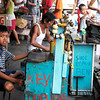 A young boy is helping his dad keep watch over a Key duplication table in a market in Malabon, Rizal, Philippines.