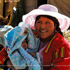 After talking to her, the young mother admitted she is 15 years old. This is on a floating Island of the Uros Tribe on Lake Titicaca, Peru.