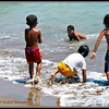 Children playing on the beach. Taken at Calyo Beach, Batangas, Philippines.