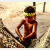 A young worker squizzing yam. Seen in the village of Alter Do Chao, Amazon River, Brazil.