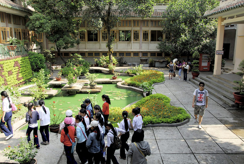School children in Ho Chi Min, Vietnam, going through a courtyard of the National Museum.