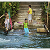 Children enjoying the Loboc river even with their clothes on. Taken in Bohol, Philippines.