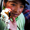 A girl selling hand puppets. Spotted in a town at the high plains of Peru.