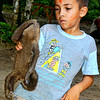 A boy and his pet sloth showing off before my camera. Spotted at Santarem village along Amazon River, Brazil.
