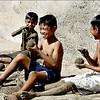 Boys making sandballs at the beach in Batangas, Philippines.