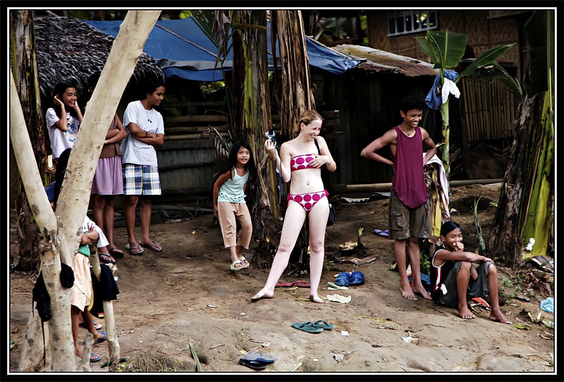 American and Pilipino kids having fun along the riverside of Loboc, Bohol, Philippines.