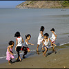 Children enjoying themselves at the beach in Calayo, Batangas, Philippines.
