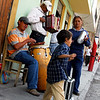 A very young boy dancing to the beat of latin music in Otavalo, Ecuador.