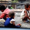 Children of poor families play at the railroad track in Divisoria market, Manila, Philippines.