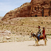 Father and son riding a donkey in Petra, Jordan.