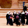 Local school girls from Amman, Jordan, in their muslim uniforms doing a celebratory dance after finishing the tour of Petra, Jordan.