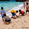 Children playing on the beach in Guimaras Island, Iloilo, Philippines.