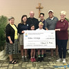 "WORK OF MERCY—Representing all the children of the Diocese of Springfield-Cape Girardeau, Bp. Edward M. Rice and four students from St. Agnes Catholic School, Springfield, presented a check May 14 in excess of $38,000 to Linda Brown, Eden Village co-founder, and Nate Schlueter, Eden Village Chief Operating Officer. As their Lenten project, the youth of the diocese raised money to build one ""micro-home"" in Eden Village for a disabled, chronically homeless individual. (Photo by Kim Brayman/<i>The Mirror</i>)"
