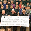 CATHOLIC SCHOOL CATEGORY—Msgr. Tom Reidy, pastor, Bishop Edward M. Rice, and Fr. Colby Elbert, associate pastor, held the check representing the final donation by students of St. Elizabeth Ann Seton Catholic School, Springfield, for the 2018 Youth Lenten project. The children of the Diocese of Springfield-Cape Girardeau made donations in excess of $38,000 in order to build a micro-home for a chronically disabled homeless person in Springfield. (<i>The Mirror</i>)