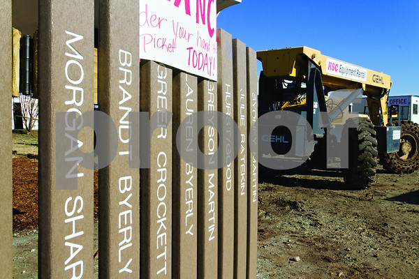 Photo by Shannon Wilson / Tyler Morning Telegraph Names are engraved onto the fence pickets which will surround the new Bullard Kids Park.  The park will be unvailed on Sunday, January 20th at 4:00.